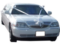 Cars for Stars (Manchester) - Wedding Limo. White Lincoln stretched wedding limousine with white ribbons